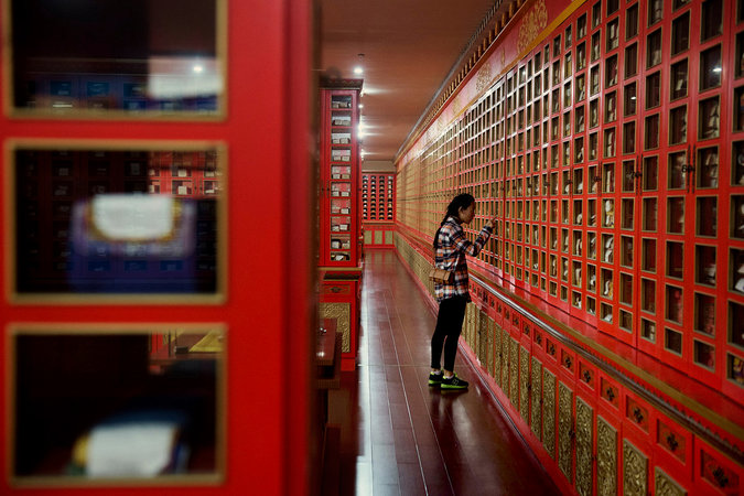 A student with Tibetan buddhism texts